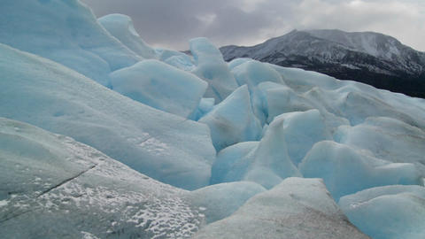 A scene from the top of a glacier across distant mountains Stock Video Footage