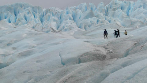 An expedition moves across a glacier landscape Footage
