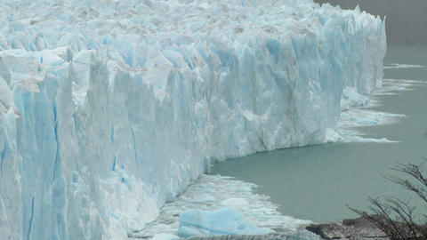 The front of a glacier is crumbling into the sea Footage
