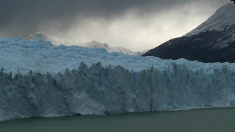 Time lapse of clouds moving across a glacier Stock Video Footage