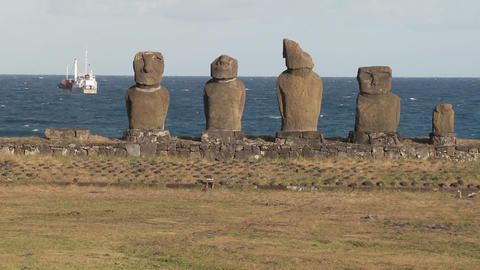 Broken statues on Easter Island with a boat Stock Video Footage