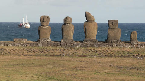 Broken statues on Easter Island with a boat Footage