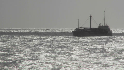 A freighter ship on a bright ocean Stock Video Footage