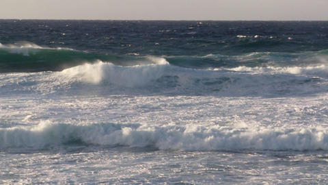 Big waves roll into a tropical island Stock Video Footage