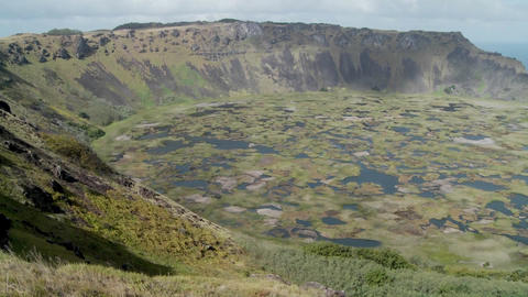Pan across an immense volcanic cone crater lake on Easter... Stock Video Footage