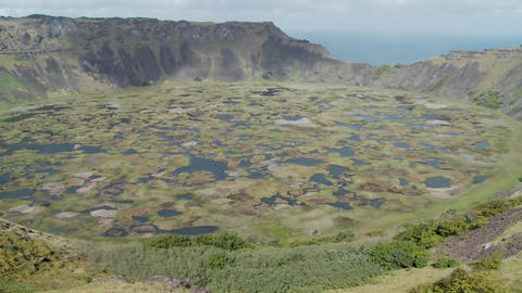 Pan across an immense volcanic cone crater lake on Easter Island Footage