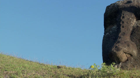 Pan to a giant stone carving on Easter Island Stock Video Footage