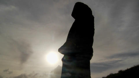 Clouds move behind Easter Island statues Stock Video Footage