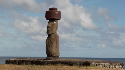 A time lapse of clouds moving behind an Easter Island statue Stock Video Footage