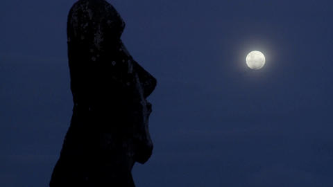An Easter Island statue is silhouetted in the moonlight Stock Video Footage