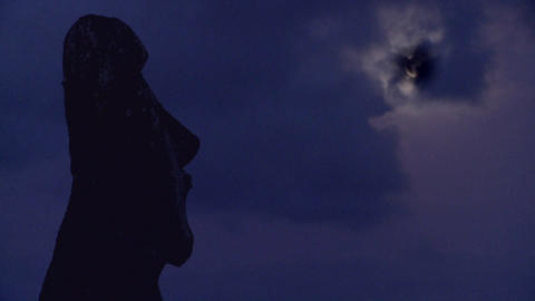 An Easter Island statue is silhouetted in the moonlight Footage