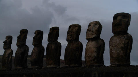 A long line of statues is silhouetted on Easter Island in... Stock Video Footage
