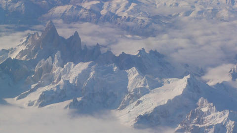 Aerial over the Andes mountain range in patagonia under heavy snow Footage