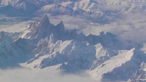 Aerial over the Andes mountain range in patagonia under... Stock Video Footage