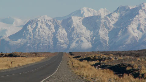 An empty road heads into the remote Andes region of Patagonia Footage