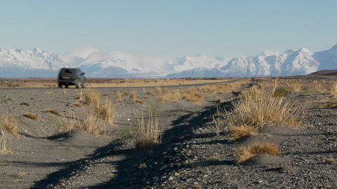 A car on a remote road heading into the Andes mountains in Patagonia, Argentina Footage