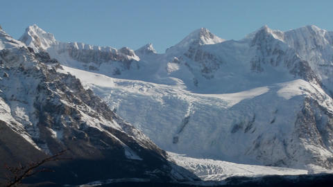 Pan across the remarkable mountain range of Fitzroy in Patagonia, Argentina with snowclad glaciers Footage
