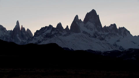 The remarkable mountain range of Fitzroy in Patagonia, Argentina at dusk Footage