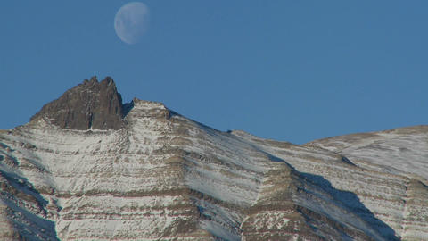 A full moon rises over the Andes mountains in Patagonia Stock Video Footage