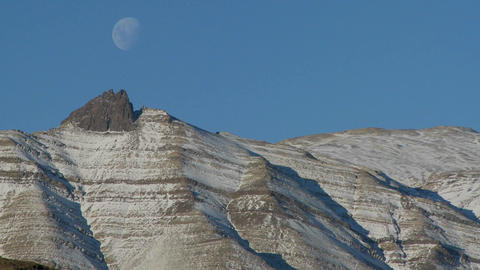 A full moon rises over the Andes mountains in Patagonia Footage