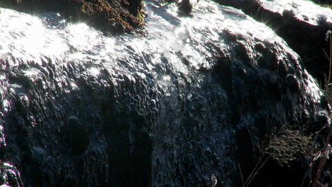 In the spring, snow and ice melts and rivulets form under... Stock Video Footage