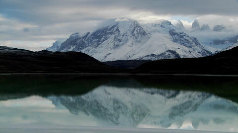 Pan across a beautiful lake in front of the peaks of Torres Del Paine in Patagonia, Argentina Footage