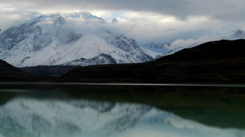 Remarkable time lapse shot of clouds flowing over the mountains at Torres Del Paine National Park, P Footage