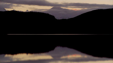 Pan across lakes and peaks in Patagonia, Argentina at dusk Footage