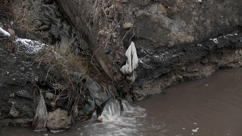 Polluted water flows into an irrigation ditch Footage