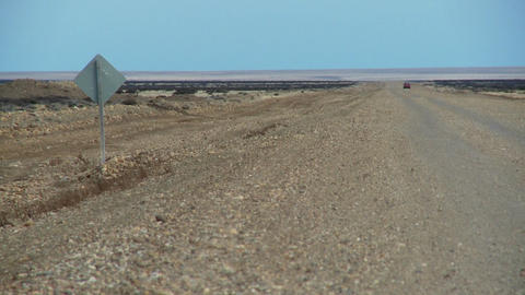 A distant car on a lonely road Footage