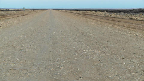Pan across a perspective down a lonely abandoned road Stock Video Footage
