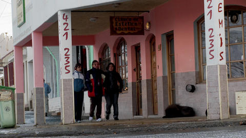 People walk on the streets of an Argentina or Chile town... Stock Video Footage