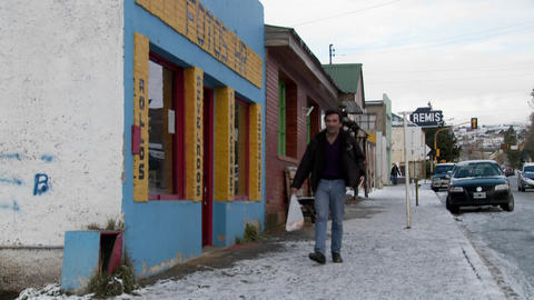 People walk on the streets of an Argentina or Chile town in winter Footage