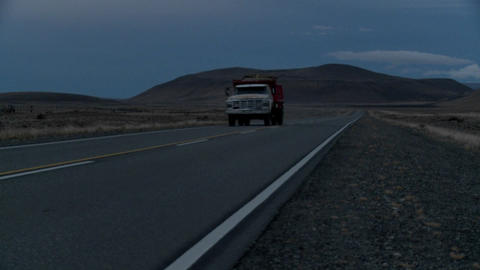 Side view of an old truck passing on a lonely road at... Stock Video Footage