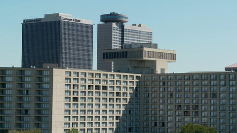 A generic conference center or hotel with many rooms and windows with tall buildings behind Footage