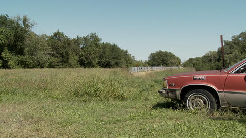 """A car is cut in half with the sign Divorced She Got 1/2""""... Stock Video Footage"""
