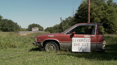 "A Car Is Cut In Half With The Sign Divorced She Got 1/2"" On It stock footage"