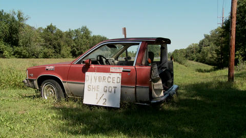 "A car is cut in half with the sign Divorced She Got 1/2""... Stock Video Footage"