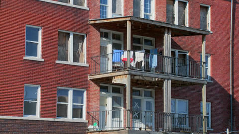 Laundry blows on the back porch of a tenement Footage