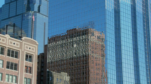 Older buildings of Kansas City reflect in the mirrored high rises Footage
