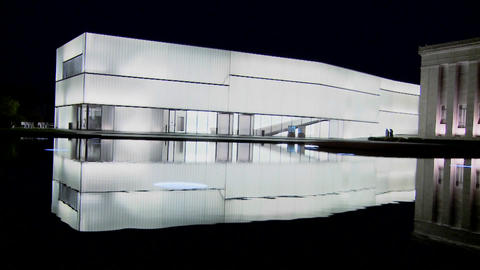 A modern building is illuminated and glows from the inside Stock Video Footage