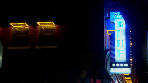 A neon sign reads The Blue Room Footage