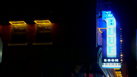 A neon sign reads The Blue Room Stock Video Footage