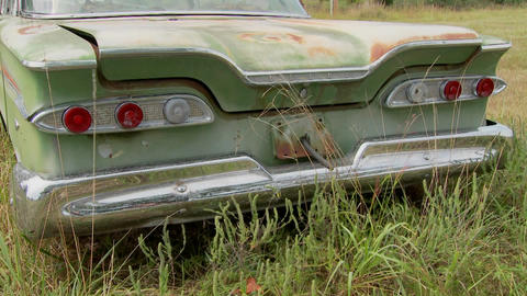 An old Ford Edsel sits in a field Footage
