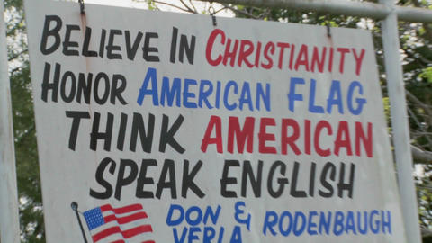 A sign in rural Appalachia says to honor the flag, speak English and think American Live Action