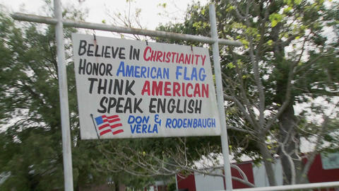 A sign in rural Appalachia says to honor the flag, speak... Stock Video Footage