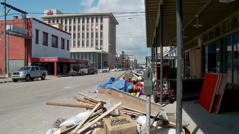 Junk and refuse sits on the street during the cleanup after Hurricane Ike in Galveston, Texas Footage
