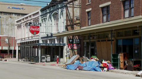 Junk and refuse sits on the street during the cleanup... Stock Video Footage