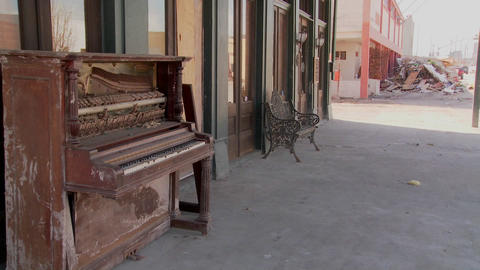 An old piano sits in front of a Glaveston bar after... Stock Video Footage
