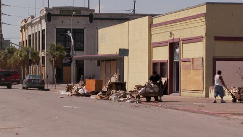 Cleanup crews work in Galveston Texas after Hurricane Ike Stock Video Footage